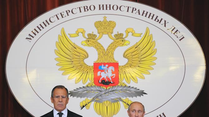 """Russia's President Vladimir Putin, right, and Foreign Minister Sergey Lavrov  Russian Ambassadors during their meeting in the Foreign Ministry, in Moscow, Monday, July 9, 2012. Russian President Vladimir Putin says that the Syrian government and opposition groups should be """"forced"""" to start a dialogue as Moscow hosted a meeting with opposition leaders. (AP Photo/ Aleander Nemenov, pool)"""
