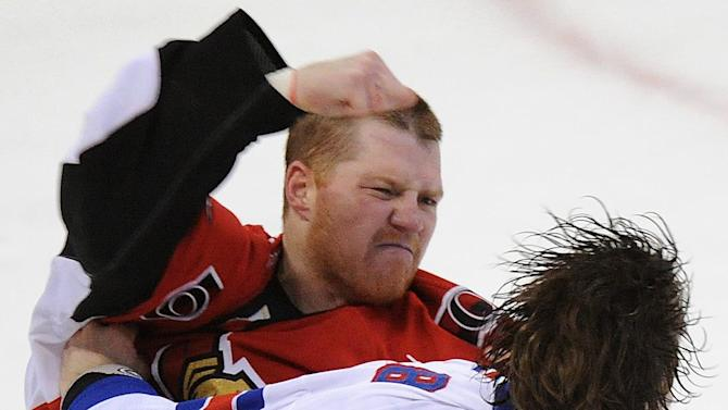 Ottawa Senators' Chris Neil fights New York Rangers' Brandon Prust, right, during the first period of Game 6 of a first-round NHL Stanley Cup playoff hockey series, in Ottawa, Ontario, on Monday, April 23, 2012. (AP Photo/The Canadian Press, Sean Kilpatrick)