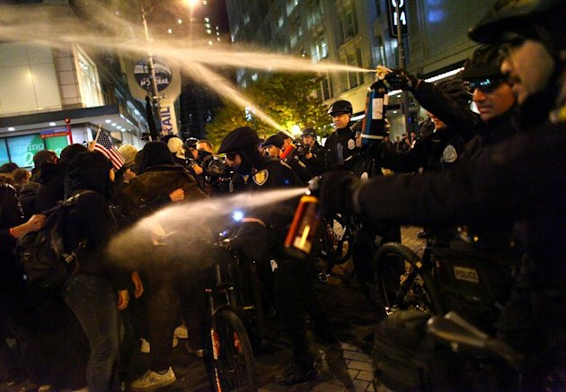 Seattle Police officers deploy pepper spray into a crowd during an Occupy Seattle protest on Tuesday, Nov. 15, 2011 at Westlake Park in Seattle. Protesters gathered in the intersection of 5th Avenue a