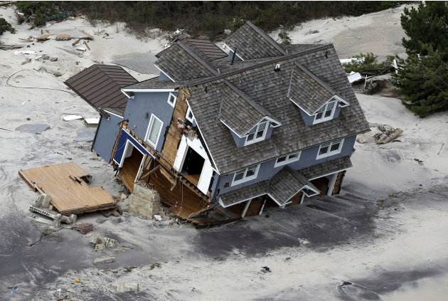 This aerial photo shows a collapsed house along the central Jersey Shore coast on Wednesday, Oct. 31, 2012, over New Jersey. New Jersey got the brunt of Sandy, which made landfall in the state and kil