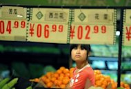 A shopper checks the prices of vegetables a market in Hefei, east China's Anhui province in May 2012. China's inflation rate slowed in September, government data showed on Monday, satisfying an official desire to control price gains, but highlighting overall weakness in the world's second-largest economy