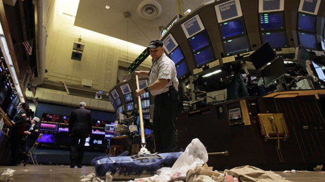 In this Friday, June 1, 2012, file photo, Raul Rodriguez sweeps the trading floor of the New York Stock Exchange. The global economy's foundations are weakening, one by one.  Already hobbled by Europe's debt crisis, the world now risks being hurt by slowdowns in its economic powerhouses. With fears of another global economic downturn, investors are sending their money to higher ground _ government bonds in the U.S. and Germany. (AP Photo/Richard Drew, File)