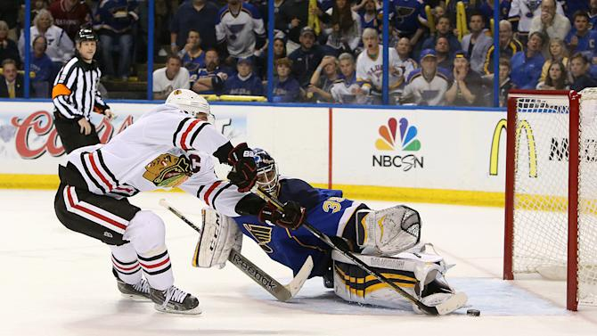 Chicago Blackhawks center Jonathan Toews (left) scores the game-winning goal in overtime past St. Louis Blues goaltender Ryan Miller during Game 5 of a Western Conference quarterfinal playoff game Friday, April 25, 2014, at the Scottrade Center in St. Louis. (AP Photo/The St. Louis Post-Dispatch, Chris Lee)