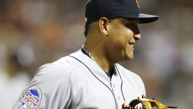 American League's Miguel Cabrera, of the Detroit Tigers, heads back to the dugout after a catching a line drive by National League's Bryce Harper, of the Washington Nationals, during the third inning of the MLB All-Star baseball game, on Tuesday, July 16, 2013, in New York. (AP Photo/Kathy Willens)