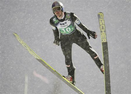 Morgenstern of Austria competes during the FIS World Cup ski jumping mixed team competition in Lillehammer