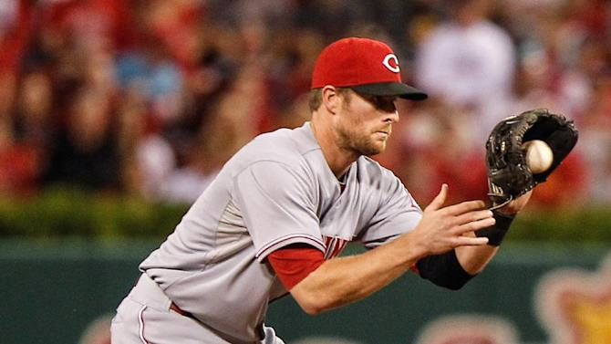 Cards clinch playoff spot, then lose 7-2 to Reds