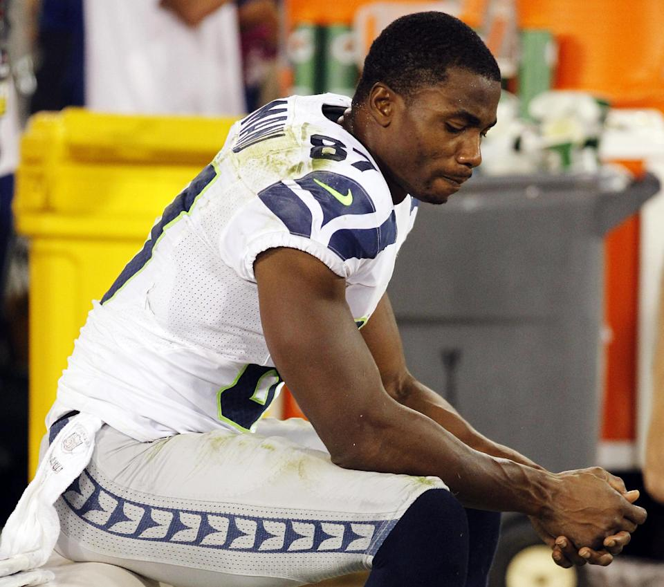 Seattle Seahawks wide receiver Ben Obomanu sits on the sideline at the end of their 13-6 loss to the San Francisco 49ers in an NFL football game in San Francisco, Thursday, Oct. 18, 2012. (AP Photo/Tony Avelar)