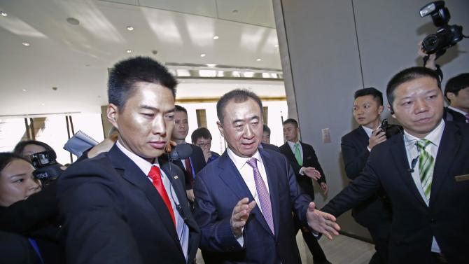 Wang Jianlin, Chairman of Wanda, leaves after a news conference for the opening of a Wanda movie park in Wuhan