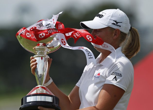 Lewis of the U.S. holds her trophy after winning the HSBC Women's Champions golf tournament in Singapore's island of Sentosa