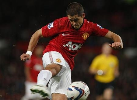 Manchester United's Hernandez shoots at goal during their English League Cup soccer match against Newcastle United at Old Trafford in Manchester