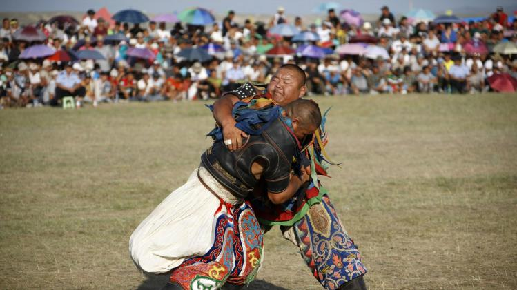 Wrestlers fight during the traditional Nadam Fair in Xilin Gol League
