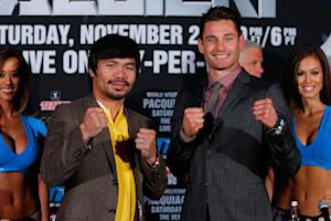 Manny Pacquiao (L) and Chris Algieri attend the Manny …