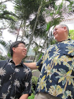 Ethan Wung, left, and Keola Akana pose for photos in Honolulu on Friday, Nov. 29, 2013. They will be among the first same-sex couples to be legally married in Hawaii on Dec. 2, when a new law allowing gay couples to marry takes effect. (AP Photo/Jennifer Sinco Kelleher).