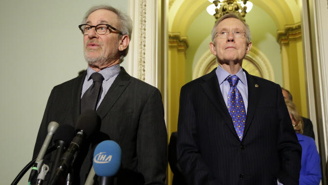 "Director Steven Spielberg, left, speaks during a media availability with Senate Majority Leader Harry Reid of Nevada, right, before a screening of the movie ""Lincoln,"" for members of Congress, on Capitol Hill, Wednesday, Dec. 19, 2012 in Washington. (AP Photo/Alex Brandon)"