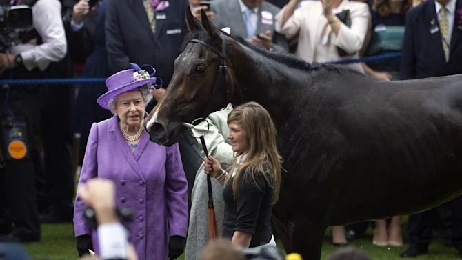 Britain's Queen Elizabeth II with her horse, Estimate, pictured in the winner's enclosure after it won the Gold Cup on the third day of Royal Ascot in Berkshire, west of London, on June 20, 2013