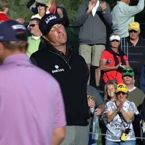 Phil Mickelson holes his 15-foot putt for birdie at Waste Management