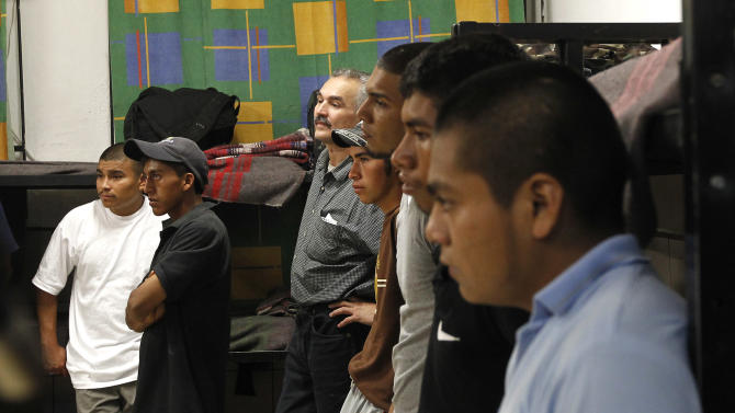 Dozens of immigrants, many of them Mexican citizens, gather in sleeping quarters at a well known immigrant shelter, as many are making tough decisions on whether to try their luck at trying to make it to the United States, by illegally crossing the border, Thursday, Aug. 9, 2012, in Nogales, Mexico.  The U.S. government has halted flights home for Mexicans caught entering the country illegally in the deadly summer heat of Arizona's deserts, a money-saving move that ends a seven-year experiment that cost taxpayers nearly $100 million.(AP Photo/Ross D. Franklin)