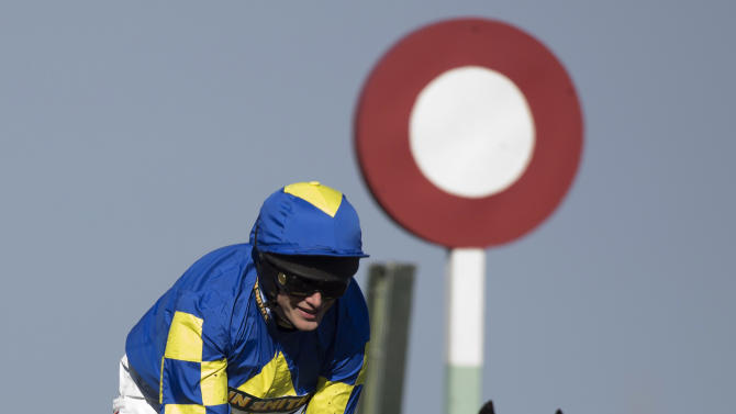 Jockey Ryan Mania heads over the line to win the Grand National horse race on Auroras Encore, at Aintree Racecourse Liverpool, England, Saturday, April 6, 2013. (AP Photo/Jon Super)