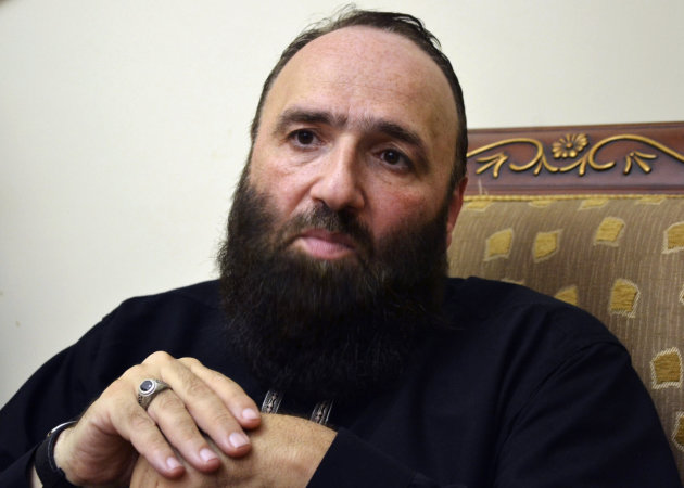 Islamist preacher Omar Bakri attends an interview with Reuters at his home in Tripoli, northern Lebanon