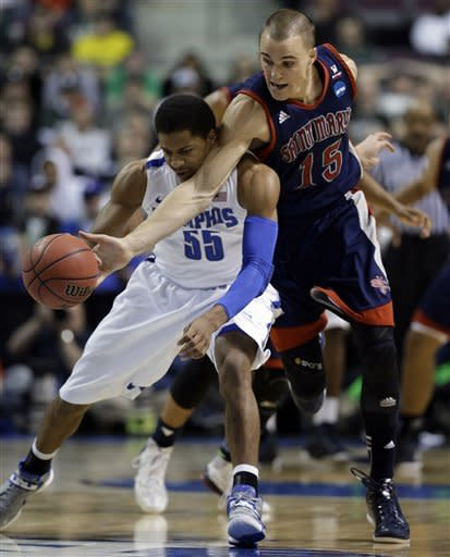 Memphis avoids late collapse, tops Gaels 54-52