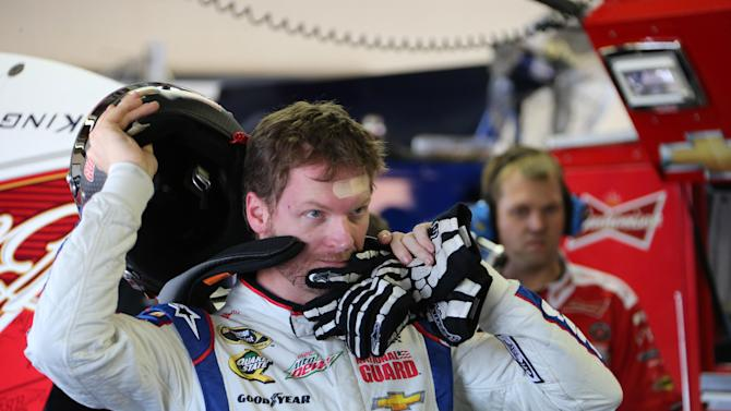 Driver Dale Earnhardt Jr., prepares for a practice session for Sunday's NASCAR Sprint Cup series auto race at Michigan International Speedway Friday, June 14, 2013, in Brooklyn, Mich. (AP Photo/Bob Brodbeck)