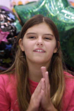 Kali Hardig, 12, who survived a rare and often fatal infection caused by a brain-eating amoeba, claps at Arkansas Children's Hospital in Little Rock, Ark., before being released Wednesday, Sept. 11, 2013. Before Kali, doctors could only point to one known survivor in the U.S. and another in Mexico of the infection. (AP Photo/Danny Johnston)