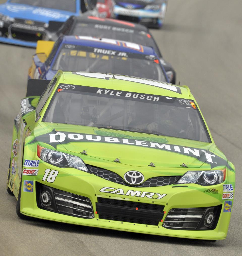 Kyle Busch (18) leads the field during the NASCAR Sprint Cup series auto race at Chicagoland Speedway in Joliet, Ill., Sunday, Sept. 15, 2013. (AP Photo/Warren Wimmer)