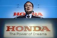 Takanobu Ito, president and CEO of Japan's auto maker Honda Motor makes a speech during a press conference at the headquarters in Tokyo on September 21, 2012. Ito expressed hope Monday that China and Japan will resolve their row over disputed islands given the key economic ties between the two countries