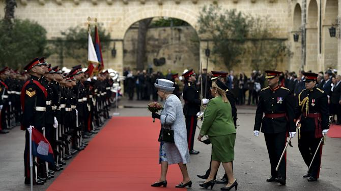 Britain's Queen Elizabeth walks with Maltese President Marie Louise Coleiro as she arrives at San Anton Palace in Attard, for the Commonwealth Heads of Government Meeting (CHOGM) in Malta