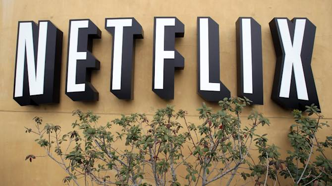 FILE - In this April 22, 2011 file photo, the logo of Netflix is displayed at the headquarters in Los Gatos, Calif. Netflix is lowering its U.S. subscriber expectations for the third quarter because of customer losses relating to a split of its DVD and streaming options. (AP Photo/Paul Sakuma, File)