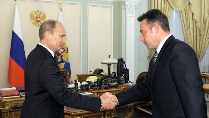 Russian President Vladimir Putin shakes hands with Igor Kholmanskikh, right, a section head at the Uralvagonzavod tank factory in the Urals city of Nizhny Tagil that builds battle tanks, in Novo-Ogaryovo residence outside Moscow on Friday, May 18, 2012. President Vladimir Putin has given the senior government post to a tank factory worker who has offered to come to Moscow with fellow laborers to disperse opposition protests. (AP Photo/RIA Novosti, Yana Lapikova, Government Press Service)