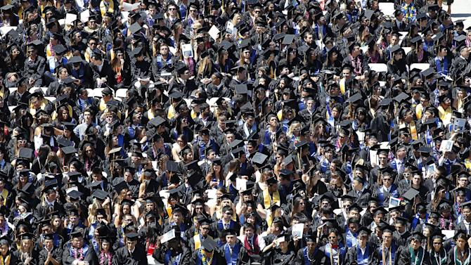 Graduating students listen to Apple co-founder Steve Wozniak deliver a commencement speech at the University of California at Berkeley on Saturday, May 18, 2013 in Berkeley, Calif. (AP Photo/Tony Avelar)
