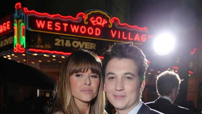 """Sarah Wright and Miles Teller at the LA premiere of """"21 and Over"""" at the Westwood Village Theatre on Thursday, Feb. 21, 2013 in Los Angeles. (Photo by Eric Charbonneau/Invision/AP)"""