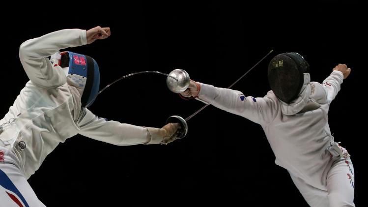 Grumier of France competes against Jung of South Korea in the men's team epee final match at the World Fencing Championships in Kazan