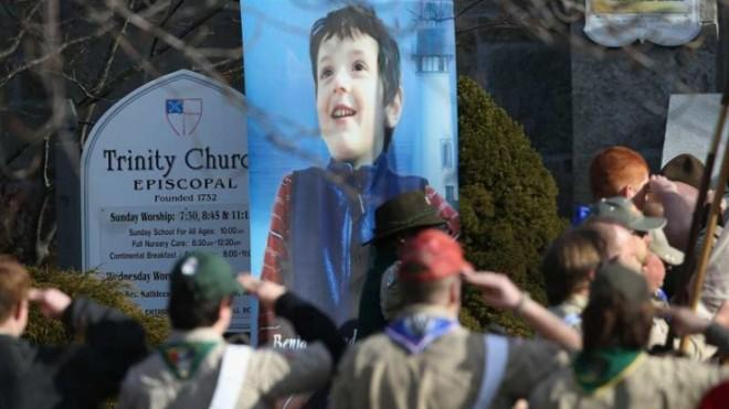 Boy Scouts salute a funeral procession for Benjamin Wheeler, 6, who was killed in the Sandy Hook massacre.