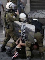 <p>Police detain a protester during the demonstration marking the 24-hours general strike in Greece.</p>
