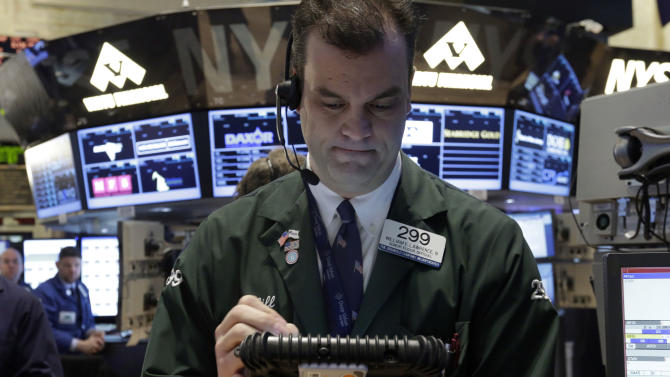 Trader William Lawrence works on the floor of the New York Stock Exchange, Friday, Jan. 25, 2013. Stocks are opening higher on Wall Street ahead of what is expected to be more upbeat data on housing from the government. (AP Photo/Richard Drew)