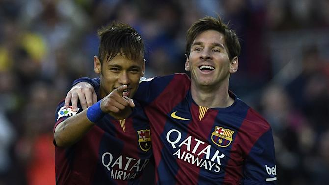 Barcelona's forward Neymar (L) and Lionel Messi (R) celebrate after scoring during the Spanish league football match against Getafe in Barcelona on April 28, 2015