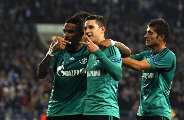 Schalke 04's Boateng and Draxler celebrata goal against Steaua Bukarest during their Champions League group E soccer match in Gelsenkirchen