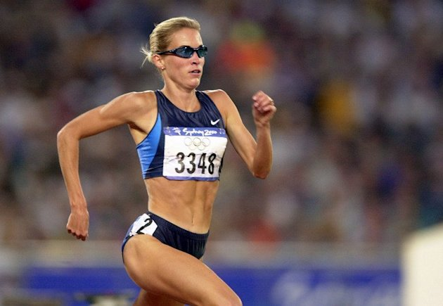 Suzy Favor Hamilton from the US runs in the women's 1500m semifinals on September 28, 2000, in the Sydney Olympic Games. Favor Hamilton admitted on Thursday that she has led a secret life for the past year as a Las Vegas escort