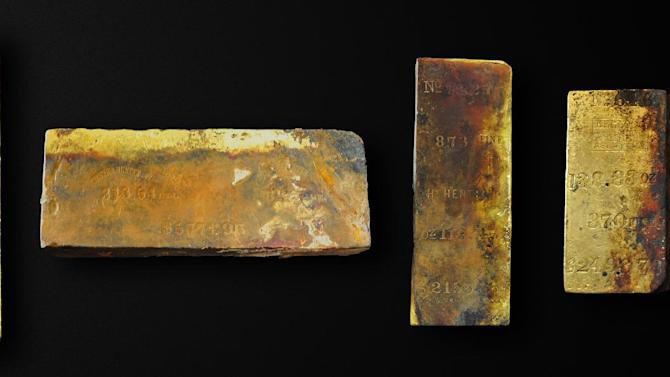 Five gold bars recovered from the wreck of the S.S. Central America off the South Carolina coast are seen in this April 15, 2014, photograph provided by Odyssey Marine Exploration Inc. Odyssey announced on Monday, May 5, 2014, that the bars are among nearly 1,000 ounces of gold that has been initially recovered from the wreck of the ship that sank during a hurricane in 1857. An earlier expedition a quarter-century ago recovered gold bars and coins worth about $50 million at that time. (AP Photo/Courtesy Odyssey Marine Exploration Inc.)
