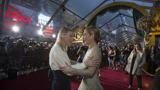 """Cast members Blanchett and James greet each other at the premiere of """"Cinderella"""" at El Capitan theatre in Hollywood"""