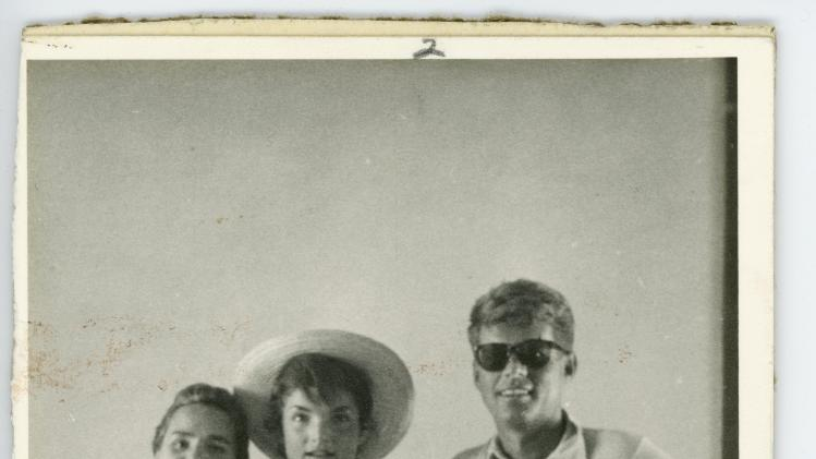 FILE - This undated file photo provided by John McInnis Auctioneers shows late President John F. Kennedy, right, with his wife, Jacqueline, center, and sister-in-law Ethyl Kennedy, left. The photograph is part of a collection of John F. Kennedy memorabilia from the family of David Powers, a former special assistant to the president, that fetched almost $2 million at auction Sunday, Feb. 17, 2013 at John McInnis Auctioneers in Amesbury, Mass. (AP Photo/John McInnis Auctioneers, File)