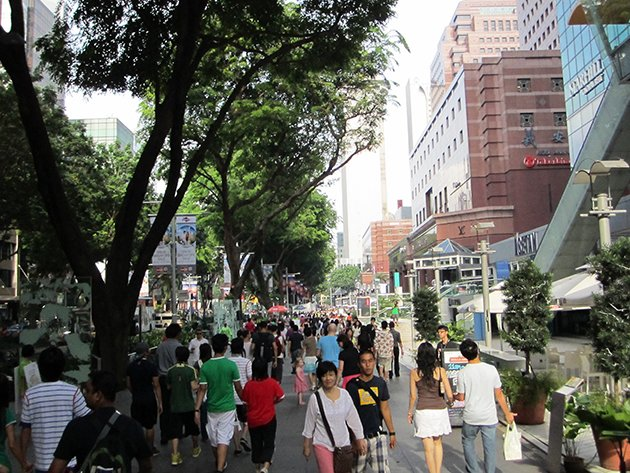 People walk along Orchard Road in Singapore. (Yahoo photo)