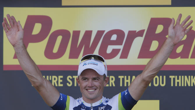 Stage winner Simon Gerrans of Australia celebrates on the podium of the third stage of the Tour de France cycling race over 145.5 kilometers (91 miles) with start in Ajaccio and finish in Calvi, Corsica island, France, Monday July 1, 2013. (AP Photo/Laurent Rebours)