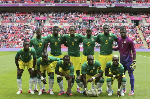 Players of Senegal line up before their men's preliminary first round Group A soccer match against Uruguay at the London 2012 Olympic Games in the Wembley Stadium in London