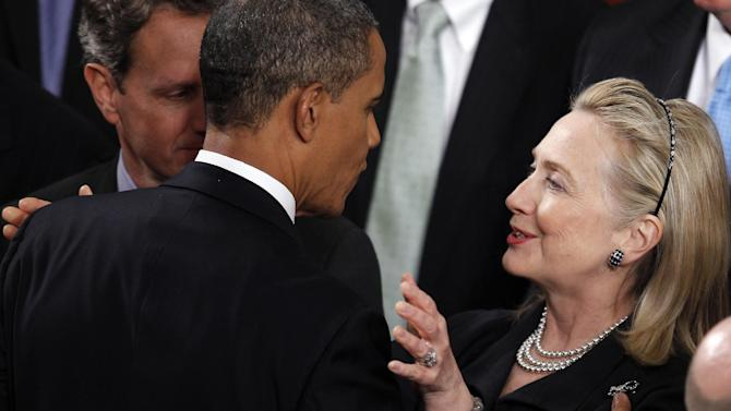 Secretary of State Hillary Rodham Clinton and Treasury Secretary Treasury Secretary Timothy Geithner greet President Barack Obama after the president delivered his State of the Union address on Capitol Hill in Washington, Tuesday, Jan. 24, 2012. (AP Photo/Evan Vucci)