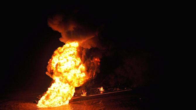 This image provided by the U.S. Coast Guard shows a pipeline burning after a collision near Bayou Perot 30 miles south of New Orleans, Tuesday March 12, 2012. The pipeline fire that was ignited when the pipe was hit by a tug boat pushing an oil barge burned into the early morning hours Wednesday in a bayou south of New Orleans. There was still liquid petroleum gas in the 19-mile pipeline and authorities were waiting for it to burn out, Coast Guard Petty Officer Alex Washington said. (AP Photo/US Coast Guard, Petty Officer 3rd Class Carlos Vega)