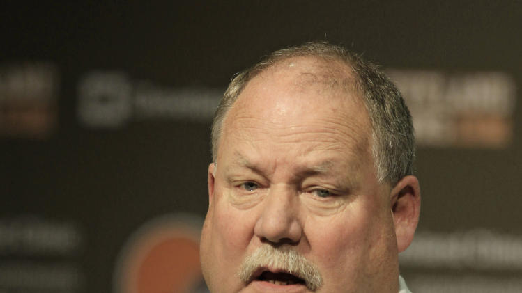Former Cleveland Browns president Mike Holmgren answers questions during a news conference Monday, Nov. 26, 2012, in Berea, Ohio. Holmgren is leaving the team immediately rather than stay on as an adviser through the end of this season. His exit raises more questions about a possible return to coaching and what he truly accomplished during his time with Cleveland.  (AP Photo/Tony Dejak)