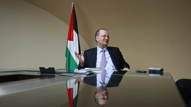 """Mohammed Mustaf, a new Palestinian deputy prime minister for economic affairs speaks during an interview with Associated Press in the West Bank city of Ramallah, Wednesday, June 12, 2013. Mustafa said that """"on the financial side, things look pretty bleak"""" and that all he can do is try harder than his predecessors and hope for a better outcome. (AP Photo/Majdi Mohammed)"""
